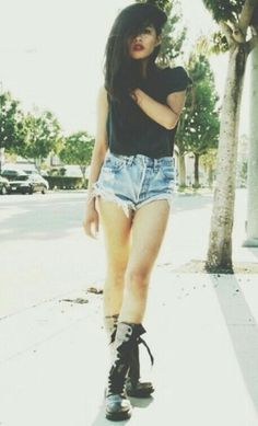 Grunge tall boots and shorts with black shirt. Longer shorts though.