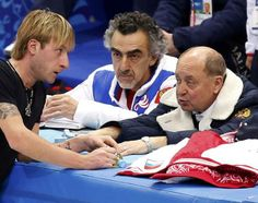 Plushenko of Russia speaks with choreographer Avdish and coach Mishin during a figure skating training session in preparation for the 2014 S...