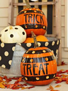 We used masking tape to make even lines on these festive pumpkins. See more Halloween door decorations: http://www.bhg.com/halloween/indoor-decorating/halloween-door-decor-28-great-ideas/?socsrc=bhgpin092612maskingtapepumpkin#page=2