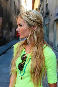 For a princess-style look, part hair in the middle, but incorporate an inverted French braid on each side. Feel free to keep it messy — the best part is that you can't go wrong no matter how you style it!