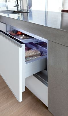 The CoolDrawer™ had a similar installation in that it also connected directly to the concrete above, screwing into the solid surface, making. Stainless Steel Benchtop, Vegetable Bin, Glass Cooktop, Built In Ovens, Exterior Cladding, Architectural Features, Walk In Pantry, White Walls, Kitchen Tools