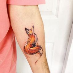 Watercolor fox tattoo on forearm by Adrian Bascur