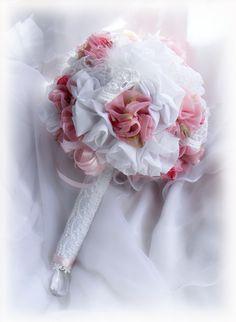 Handmade fabric roses design this  beautiful bridal prom bouquet.