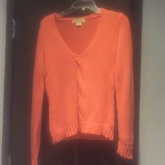 Michael Kora sweater Michael Kors sweater in very pretty orange/coral color. In great condition size medium. Please message with any additional questions. Michael Kors Sweaters Crew & Scoop Necks