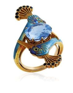 RENÉ LALIQUE - Art Nouveau Sapphire and Enamel Ring, Circa Centering an oval-cut sapphire between two peacock heads applied with blue and black enamel, with French assay mark for gold, signed Lalique. Anillo Art Nouveau, Art Nouveau Ring, Bijoux Art Nouveau, Art Nouveau Jewelry, Jewelry Art, Gold Jewelry, Vintage Jewelry, Jewelry Accessories, Fine Jewelry