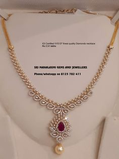 Sri Mahalaxmi Gems and Jewellers present a very simple and beautiful design of IGI certified Diamond necklace total price Rs 2.51 lakhs including changeable color stones. Stunning gold necklace studded with diamonds and rubies. Necklace with pearl hangings. Visit  for most attractive prices on ready selection or made to order. contact no 8125 782 411  12 March 2019