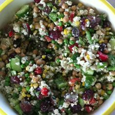 Barley Salad - its impossible to imagine the deliciousness of this salad unless you've had it!   1 cup cooked barley 1 cup cooked chick peas 1/2 cup cooked peas 1/2 cup cooked corn 1/2 cup roasted almonds 1/2 red pepper 1/2 green pepper 1/2 cucumber 1 cup red seedless grapes, halved 1/2 cup - 1 cup feta cheese 1/2 cup cilantro, chopped  1/2 cup Greek salad dressing