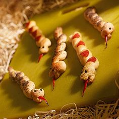 Slithering Breadsticks: Let them eat snake! Pepperoni and poppy seeds give our serpentine snacks distinctive markings.