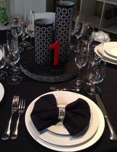 Mock up of my table for my black and white (with a touch of red) wedding. Clusters of white tea roses or hydrangeas will be tucked between each lantern. The centerpiece risers are fabric covered stacks of pizza rounds with attached bling ribbon. The lanterns are an idea from Pinterest, but I laced them together rather than wire. The table numbers are precut numbers glued to small wooden blocks and precut bases and spray painted. Next step, to make the napkin rings out of the same bling…