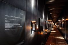 "Inside the white ""herring"" is black-lined with ninety-one windows recessed in metal frames, honouring victims individually."
