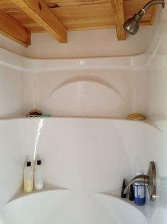 Here's a one-piece shower stall with cool shelving! One Piece Shower Stall, Tiny Fridge, Space Saving Bedroom, Building A Tiny House, Micro House, Tiny House Bathroom, Stair Storage, Cabins And Cottages, Tiny Spaces