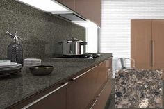 4. Mountain Mist Silestone- bottom right as a sample and background used in a kitchen.
