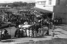 DAY 2 - A crowd gathers outside Parkland Hospital's emergency entrance, on Friday, 11/22/63. Inside, Clint Hill remained with Mrs. Kennedy as the doctors tried to save his life.