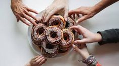 Overhead image of a group of friends sharing a pile of donuts. by Kirstin Mckee for Stocksy United Healthy Office Snacks, Happy Employees, Snack Items, Pure Fun, Home Food, Yummy Snacks, Junk Food, Tribal Tattoos, Donuts