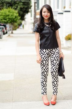 A nicely put together combination of a black leather crew-neck t-shirt and white and black leopard skinny pants will set you apart effortlessly. Let's make a bit more effort now and rock a pair of red leather pumps.  Shop this look for $113:  http://lookastic.com/women/looks/necklace-crew-neck-t-shirt-clutch-skinny-pants-pumps/4224  — Gold Necklace  — Black Leather Crew-neck T-shirt  — Black Leather Clutch  — White and Black Leopard Skinny Pants  — Red Leather Pumps