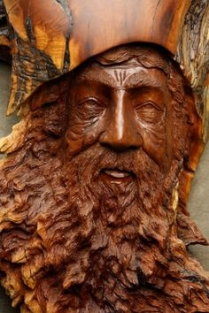 awesome wood carving of a wood spirit