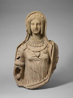 Terracotta statue of a young woman - The elaborate necklaces and armband on this statue appear to be reproduced from molds of actual jewelry. Some of the pendants are decorated with reliefs depicting various Etruscan deities and heroes. Originally, this woman wore a pair of grape-cluster earrings. When complete, the statue probably stood in a sanctuary and showed the young woman holding an incense box in her extended right hand - Etruscan - late 4th- early 3rd century BC