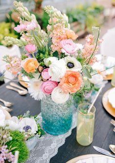 Beautiful  spring centerpiece of ranunculus, anemone, stock, and more.
