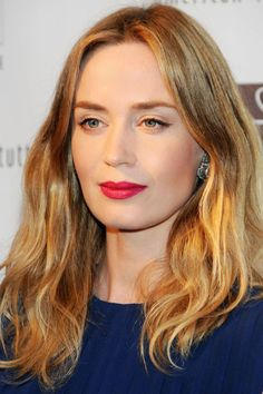 Emily Blunt proves all you need in your bag to transform casual, undone hair and bare eyes for an after-work affair is red lipstick. How to get the beauty look here: