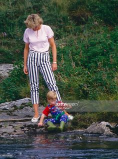 Diana, Princess of Wales, and Prince Harry play on the banks of the River Dee, near Balmoral Castle.during a Summer vacation, on August 18, 1987, in Balmoral, Scotland.