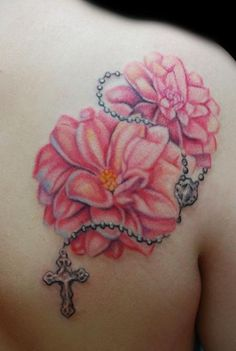 flower and rosary chain tattoo back shoulder