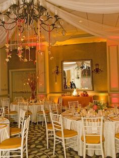 White linens, white chairs with gold cushions