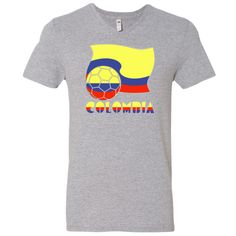 Support TEAM COLOMBIA in soccer or football with this fun design on a Men's V-Neck  T-Shirts. Image features the word COLOMBIA in the yellow, blue and red colors of the Colombian flag. Above it a soccer ball or football with the colors on the flag included. Behind the ball is a waving Colombian flag. $22.99 ink.flagnation.com