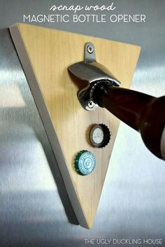 Create a wall-mounted DIY magnetic bottle opener using scrap wood via The Ugly Duckling House.