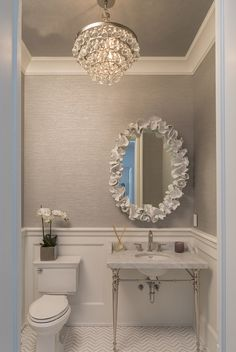 Hamptons house half bath featuring Robert Abbey for the bling chandelier…