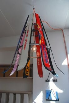 Dutch designer Willem Feeffer has created a hanging ski-chandelier for elamysmatkat, a helsinki-based travel agency with donations from old snow-sport equipment. this colourful up-cycled lamp serves as interior decoration for the office and reflects on what their office's fun and extreme winter philosophy believes.