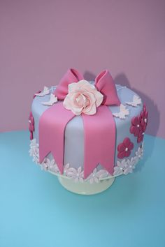 Chocolate cake with a fondant bow and gumpaste rose. All other flowers and butterflies are made out of fondant