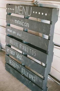 Pallet painted in chalkboard paint + used as a restaurant menu