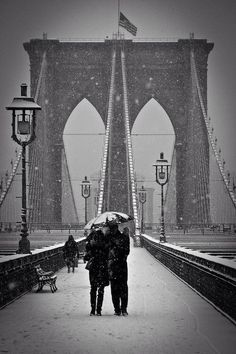 What could make the Brooklyn Bridge even more romantic? Snow!