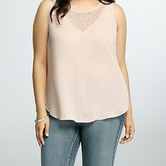Torrid Blouse Light pink and grey Torrid sleeveless blouse with silver/crystal embellishments. NWT, sz 1x, front side is pink 100% polyester and is slightly sheer, back is grey and 65% polyester, 32% rayon, and 3% spandex. torrid Tops Blouses