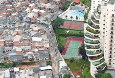 Never have so few owned so much.  There are 29.7 million people in the world with household net worth of $1 million or more; they represent just .4 percent of 7 billion people. This image of the wealth divide in Brazil really hammers home the point.