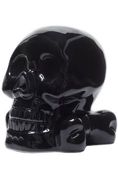 Keep your mind on your money and your money on your mind with this black, ceramic Skull Bank! The skull-n-crossbones design features a nice, sturdy base and its domineering presence will undoubtedly k