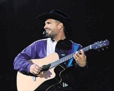 To see Garth Brooks live in concert - Done! 1998