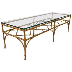 A Midcentury Faux Bamboo Gilded Metal Coffee Table with Bracket Stretcher | From a unique collection of antique and modern coffee and cocktail tables at https://www.1stdibs.com/furniture/tables/coffee-tables-cocktail-tables/