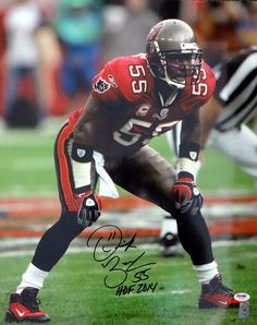 This is a 16x20 photo that has been hand signed by Derrick Brooks. The autograph has been certified authentic by PSA/DNA and comes with their sticker and matching certificate of authenticity.