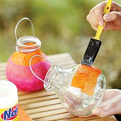 Cover glass chandelier lanterns with tissue paper to create a soft glow. Use a small foam brush to paste the tissue paper on glass. Garden Lanterns, Hanging Lanterns, Candle Lanterns, Candles, Hanging Lights, String Lights, Crafts For Kids, Diy Crafts, Family Crafts
