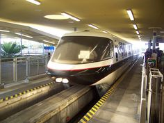 Walt Disney World's Monorail Black arrives at the Transportation and Ticket Center.