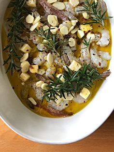 Olive oil and rosemary-poached shrimp with garlic, anchovies, and red pepper flakes // okie dokie artichokie