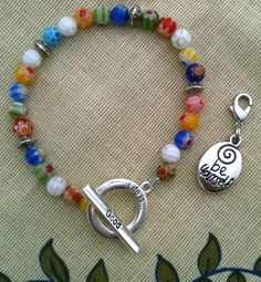 Calorie Counter Bracelet Points too Life is Good Milliefiori Tiny Flower beads. $25.00, via Etsy.