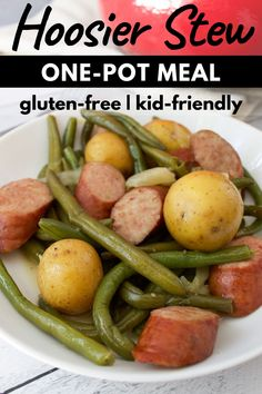 Make this Hoosier Stew! A hearty Midwestern classic that consists of green beans potatoes and smoked sausage. Its a comforting dish to enjoy on chilly fall and winter nights. Green Bean Dishes, Healthy Recipes, Free Recipes, Delicious Recipes, Easy Recipes, Green Beans And Potatoes, Greens Recipe, Unique Recipes, One Pot Meals
