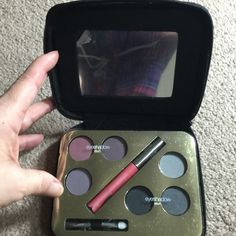 Eyeshadow / Mascara Makeup Kit With Mirror Purple ( 3 colors) and black ( 3 colors) eyeshadow a, get 2 looks with this kit, plus applicators and mascara. Complete eye lot for both day and night time, depending upon how you wear the colors. Great little kit. Makeup Eyeshadow
