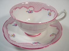 Lovely tea cup and saucer made by Collingwoods, England c.1950+ The tea cup is 2 3/8 high and the saucer is 5 1/2 diameter The rims and handle are gilt. It is in a very good condition, no chips, no hairlines and no chips and both pieces ring nicely. These items are quite old and I am