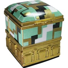This box is the height of Art Deco in color & design.  The porcelain has a black, white, seafoam green and 2 colors of gold glaze in a geometric - 1930s