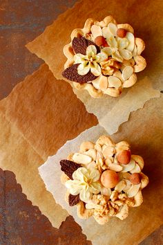 Autumn Chocolate Tartlets with walnuts, almonds, apple flowers, honey and mint chocolate leaves