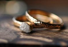 one bezel-set diamond (as chosen) in 18k white gold or yellow gold -one matching 14k white gold or yellow gold band -2.5mm half-round ring...