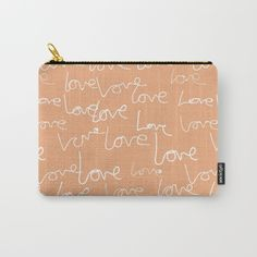 Love doodles Carry all pouch $14.00 Organize your life with our Carry-All Pouches. Available in three sizes with wraparound artwork, these pouches are perfect for toiletries, art supplies or makeup. Even an iPad fits into the large size. Features include a faux leather pulltab for easy open and close, a durable canvas-like exterior and a 50/50 poly-cotton black interior lining. Machine washable.
